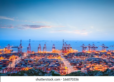 shanghai container terminal in twilight ablaze with lights