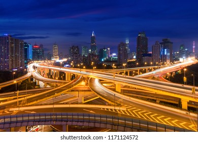 Shanghai elevated road junction and interchange overpass at night in Shanghai, China