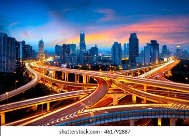 Shanghai elevated road junction and interchange overpass at night, Shanghai China