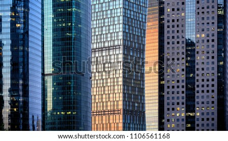 shanghai futuristic modern architecture and reflections on windows of sunset warm light in skyline and great patterns in skyscrapers in financial district Pudong Shanghai, China