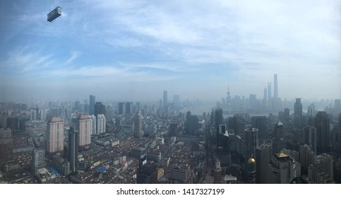 Shanghai hanging window cleaner photobombing an awesome view of the city