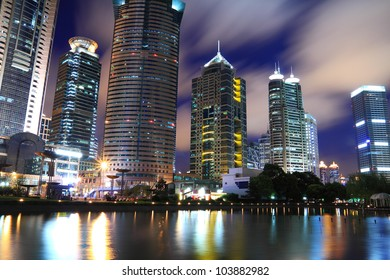 Shanghai Lujiazui Finance & City Buildings reflected in the pond night landscape