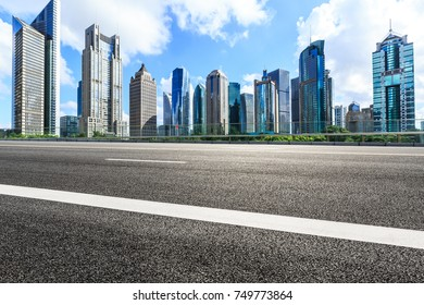 Shanghai Lujiazui financial district commercial buildings and asphalt road scenery,China