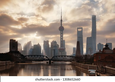 Shanghai morning with sunny sky and water reflections in China.