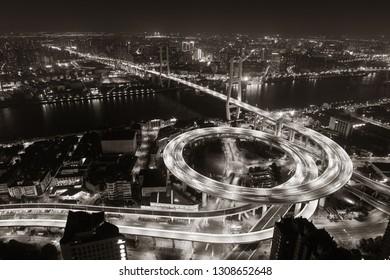 Shanghai Nanpu Bridge over Huangpu River with busy traffic in China.