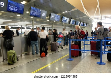 SHANGHAI - OCT 26, 2018: Passengers check in at United Airlines counter at Shanghai Pudong International airport.