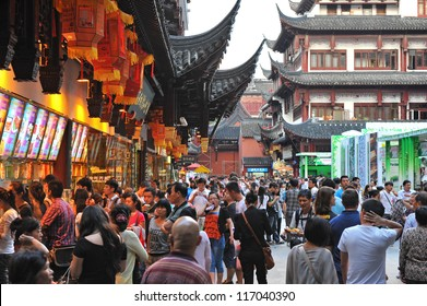 SHANGHAI - OCT 5: tourists visit Yuyuan garden during Chinese National Day holiday on October 5, 2012 in Shanghai, China. During this holiday around 740 million trips will be made by Chinese people.