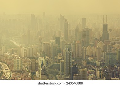 "SHANGHAI - OCT 8: view of heavily polluted city center on October 8, 2014 in Shanghai, China. Air quality index levels were classed as ""Beyond Index"" (PM 2.5 of over 500 micrograms per cubic meter)."
