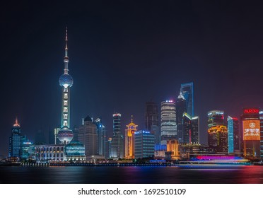 Shanghai, Pudong, Lujiazui, China - May 4, 2010: Night skyline of colorfully lighted skyscrapers across Huangpu river, as seen from the Bund.