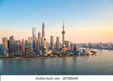 shanghai pudong skyline and huangpu river at dusk
