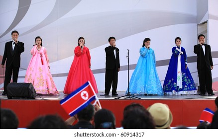 SHANGHAI - SEP 06: Pyongyang Arts Troupe performs on stage during the DPRK National Pavilion Day celebrations at Shanghai World Expo 2010 on Sept 06, 2010 in Shanghai, China