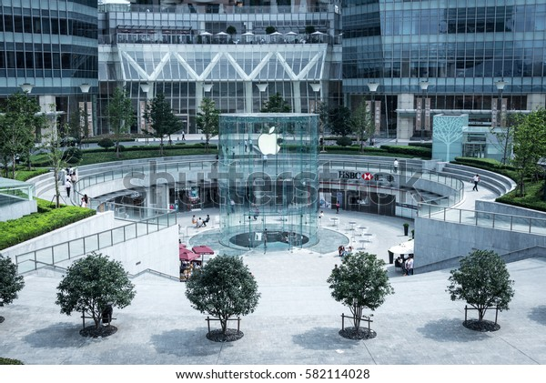 SHANGHAI - SEPTEMBER 11: Wide angle view of the base of the International Finance Center in the Pudong district in Shanghai, with the iconic glass entrance to the Apple Store, on September 11, 2012.