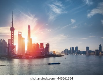 shanghai skyline against a blue sky with beautiful huangpu river