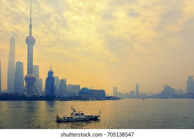 Shanghai skyline and business tower in sunny morning with cloud sky, misty and Huangpu river cityscape view