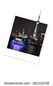 Shanghai skyline by night in a photo frame isolated on white background