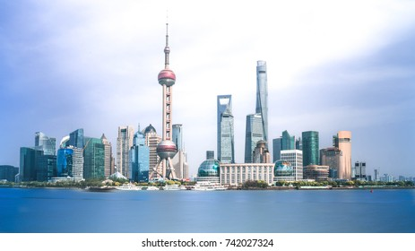 Shanghai skyline and Huangpu river in a sunny day