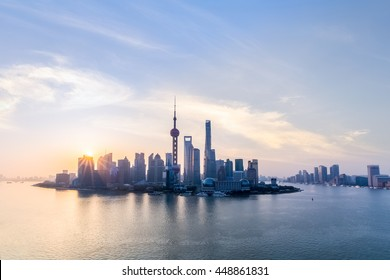 shanghai skyline and huangpu river in sunup , charming metropolitan background