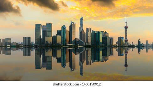 Shanghai skyline with modern urban skyscrapers at sunset,China