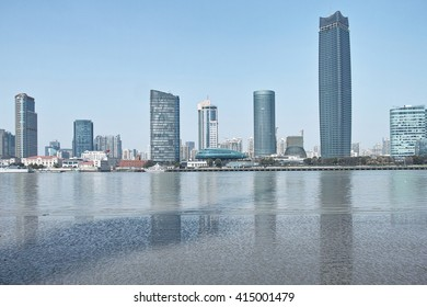 Shanghai skyline with modern urban skyscrapers on the Huangpu River, China.