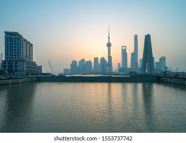 shanghai skyline panorama in sunset, pudong financial center with huangpu river, China