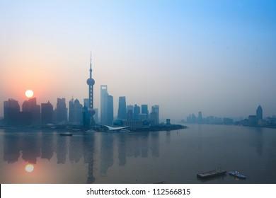 shanghai skyline and reflection in sunrise