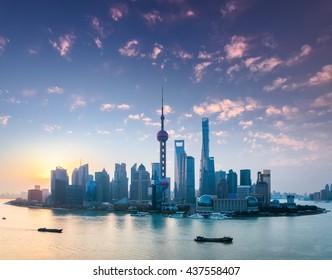 shanghai skyline in sunrise , the rosy colour of dawn spreads all over the sky.
