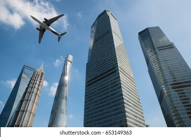 Shanghai skyscrapers buildings and a plane flying overhead at in Shanghai luajiazui finance and business district in morning at Shanghai, China