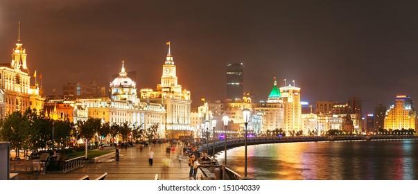 Shanghai Waitan night view with historic buildings over Huangpu River panorama