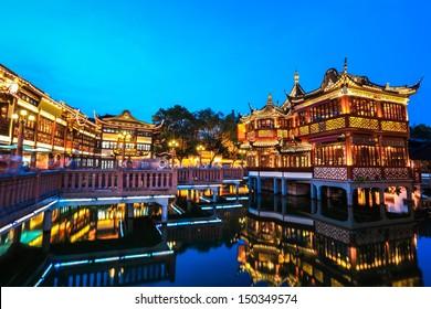 shanghai yuyuan garden with reflection in the lake at night,China.