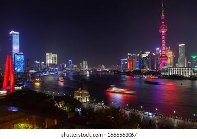 Shanghai/China - July 05 2019: Chinese boats reflected on Huangpu in Shanghai