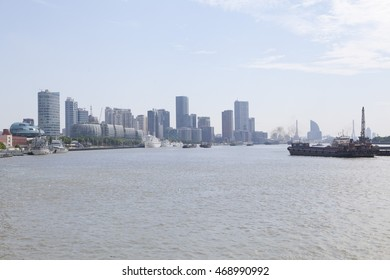 Shanghai,China - June 26,2016 : View of the Bund on summer day on June 26,2016 in Shanghai,China. It is a waterfront area which runs along the western bank of Huangpu River, facing Pudong skyscrapers.