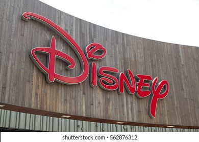 Shanghai,China - June 27,2016 : Disney sign on building at Lujiazui Financial District in a cloudy day in Shanghai, China on June 26,2016.