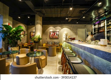 SHANGHAI-CHINA, MAR,19,2016: Interior of cafe-bar with beautiful flowers at Xintiandi in Shanghai China.