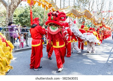 Shanghai,China - on February 11,2017:Dragon and lion parade dance show in the Chinese Lantern Festival.
