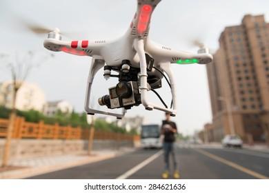 SHANGHAI,CHINA-April 30,2015:Flying drone quadcopter Dji Phantom 2 with digital camera GoPro HERO4.