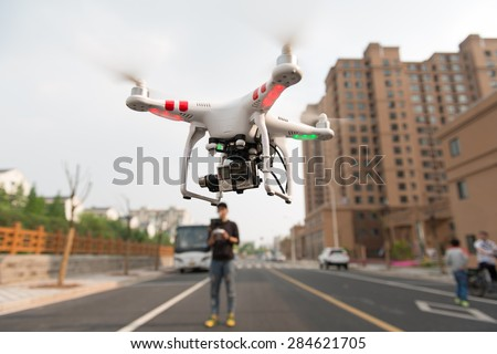 SHANGHAI,CHINA-April 30,2015:Flying drone quadcopter Dji Phantom 2 with digital camera GoPro HERO4.