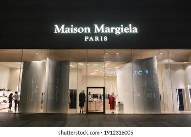 Shanghai.China-Feb.2021: Facade of large Maison Margiela store at night. A French luxury fashion brand