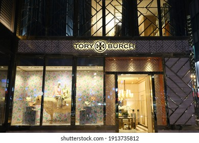 Shanghai.China-Feb.2021: Facade of tory burch store at night. An American luxury brand