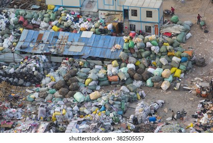 Shanghai,China-February 20,2016:Chinese working at the garbage disposal site