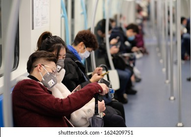 Shanghai/China-Jan.2020: New type coronavirus COVID-19 pneumonia in Wuhan has been spreading into many cities in China. People wearing surgical mask sitting in subway in Shanghai
