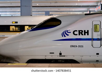 Shanghai/China-May 2019: close up side of China Railway High-Speed train locomotive in Shanghai Hongqiao Railway Station. Bullet shaped cab and door on white train