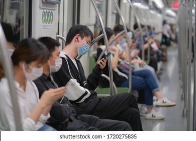 Shanghai/China-May.2020: To prevent infection of coronavirus COVID-19 pneumonia, passengers wearing surgical mask sitting in subway train.