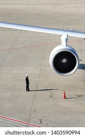 SHANGHAI,CHINA-NOVEMBER 30, 2008:Guard on the runway to protect the airplane of unwanted visiters