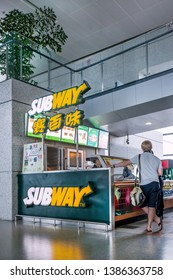 SHANGHAI-JUNE 11, 2013. Subway outlet inside Hongqiao Airport. Subway, famous for its six-inch and foot-long sandwiches, is going to close 500 Restaurants in the US and opening 1,000 overseas.