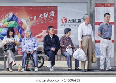 SHANGHAI-JUNE 3. Chinese elderly at bus stop. China's elderly surpasses 200 million in 2014, top 300 million by 2025. By 2042, more than 30% of China's population ages over 60. Shanghai, June 3, 2013.