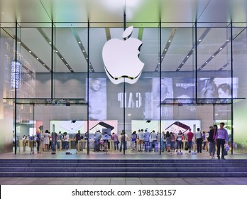 SHANGHAI-JUNE 5, 2014. Apple flag-store in Nanjing East Road at night. According Umeng, China's largest analytic firm, 27% of China's smartphones cost over $500, and 80% of those are i Phones.