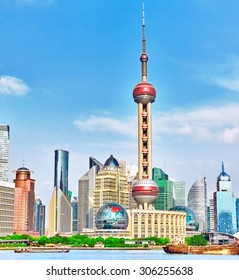 SHANGHAI-MAY 24, 2015 Oriental Pearl Tower on  blue sky background.Tower  470 meter the Oriental Pearl is one of Shanghai's tallest buildings, at Lujiazui finance and trade zone in Pudong district.