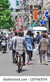 SHANGHAI-MAY 5, 2014. Busy streetlife in Shanghai. the largest city in China by population, and the second most populous city proper in the world, with a population of more than 24 million as of 2017