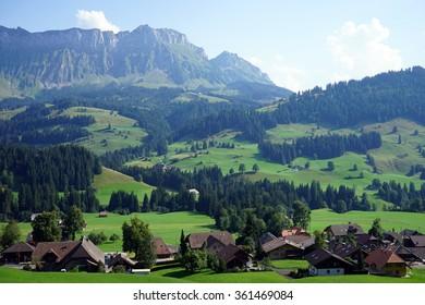 SHANGNAU, SWITZERLAND - CIRCA AUGUST 2015 Street of town in the valley near mountain area in Switzerland
