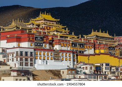 Shangri-La, China - January, 2021: The buildings of Buddhist Ganden Sumtseling Monastery (Songzanlin Monastery) in Shangri-La, Yunnan with the sun shining on the buildings of the manastery